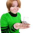 Girl with a glass and tablets — Stock Photo
