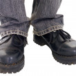 Feet in the big black boots — Stock Photo