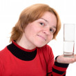 The girl with a water glass - Stock Photo