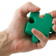 Royalty-Free Stock Photo: Puzzle slice in a hand