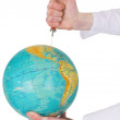 Terrestrial globe and syringe — Stockfoto