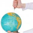 Terrestrial globe and syringe — Stock Photo #1795602