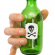 Hand with green bottle pictured skull — Stock Photo