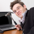 Businessman in spectacles gone mad — Stock Photo #1795895