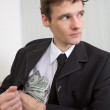The man hides money — Stock Photo #1796187