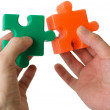 Hand and puzzle — Stock Photo