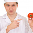 Stock Photo: Cook with tomato in hand
