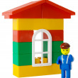 Toy house and little man — Stockfoto