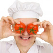 Stock Photo: Cook with red tomato