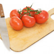 Red tomatoes and kitchen knife - Stock Photo