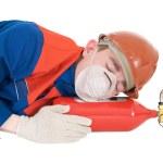 Sleeping with fire extinguisheron — Stock Photo #1798262