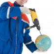 Laborer with hand drill and globe — Stock Photo