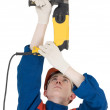 Builder and perforator - Stock Photo