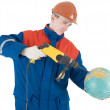 Builder, terrestrial globe, perforator - Stock Photo