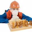 Builder and chess - Stock Photo