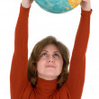 Woman and terrestrial globe — Stock Photo