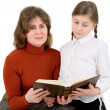 Woman and girl reads the book — Stock Photo