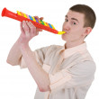 Young man and toy, trumpet — Stock Photo #1799034