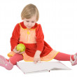 Stock Photo: Little girl reads a book