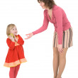 Foto Stock: Woman asks apple beside little girl