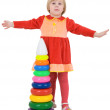 Little girl and toy pyramid — Stock Photo #1799061