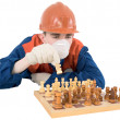 Builder play in chess - Stock Photo