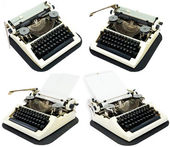 Ancient typewriters on a white — Stock Photo