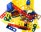 A bunch of colorful detail meccano on a white background — Stock Photo