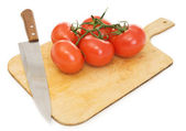 Red tomatoes and kitchen knife — Stock Photo