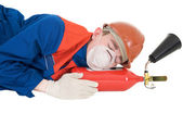 Sleeping with fire extinguisheron — Stock Photo