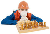 Builder and chess — Stock Photo