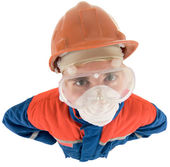 Laborer on the helmet and respirator — Stock Photo