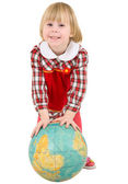 Little girl and terrestrial globe — Stok fotoğraf