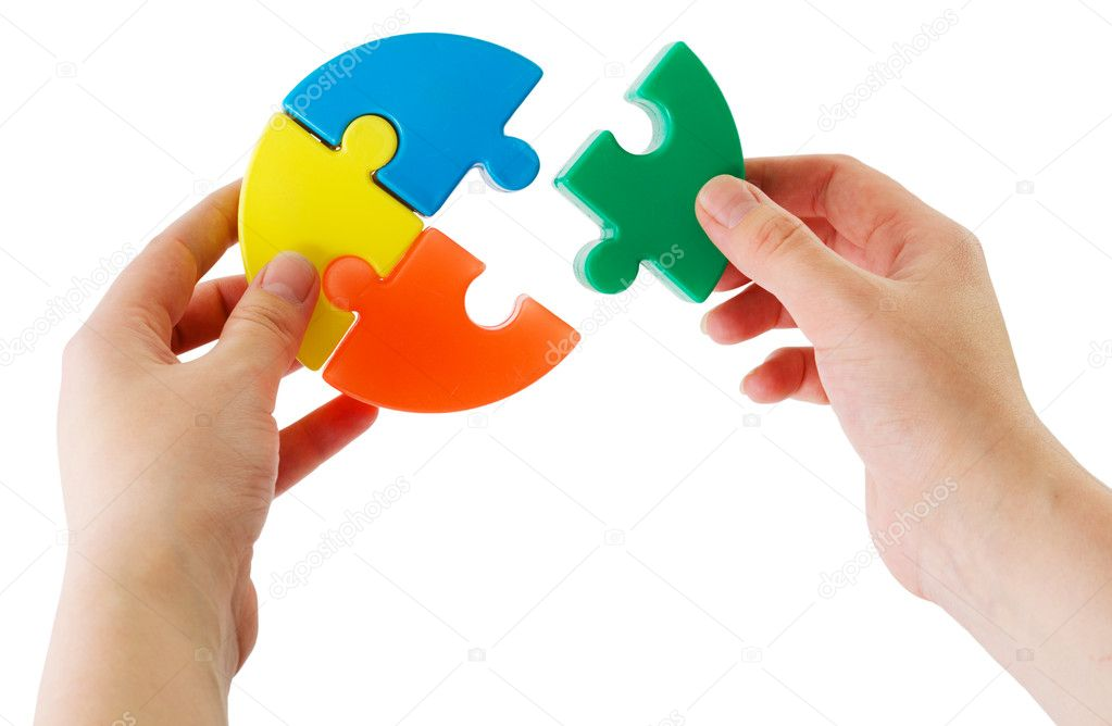 Hands keeping slice puzzle try its collect  Stock Photo #1796737