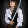 The girl - pirate with a sabre in hands — Stock Photo
