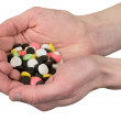 Multicolore tablets on hand — Stock Photo