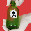 Green bottle with skull and crossbones — Stock Photo #1801675