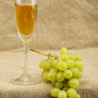 Wineglass with wine and grapes — Stock Photo