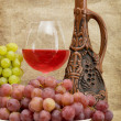 Royalty-Free Stock Photo: Ceramic bottle, grapes and red wine