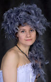 Portrait of thel girl with a boa — Stock Photo