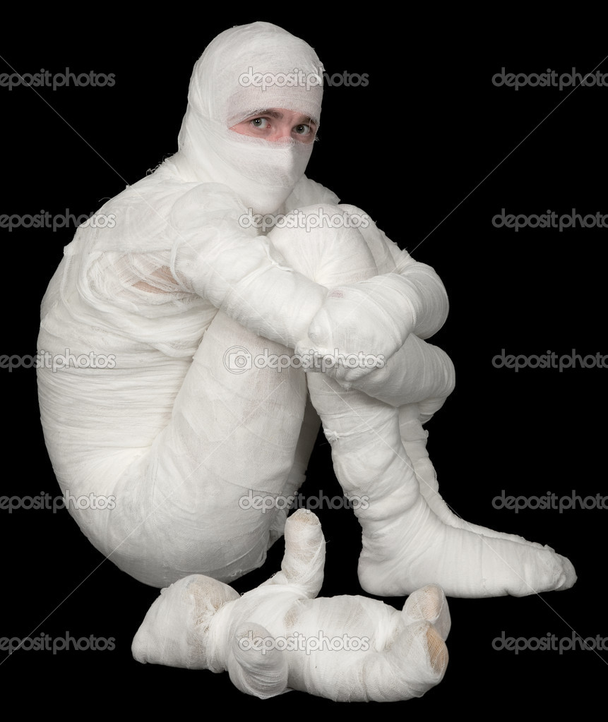 Egyptian mummy emo sitting on a black and mummy bear — Stock Photo #1800717