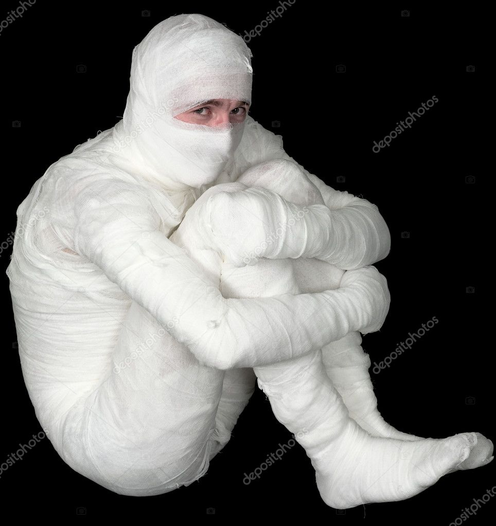 Egyptian mummy emo sitting on the black background  Stock Photo #1801194