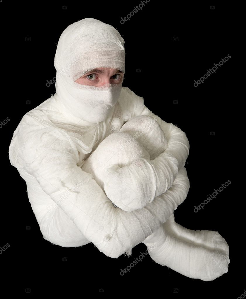 Egyptian mummy emo sitting on the black background — Stock Photo #1801802