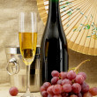 Champagne, bucket, goblet and grapes - Stock Photo