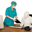 Bandaged businessman and nurse — Stock Photo
