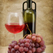 Green bottle, goblet and grapes — Stock Photo #2261365