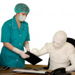 The bandaged boss and nurse — Stock Photo