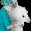 Royalty-Free Stock Photo: Doctor to give bandaged patient