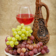 Ceramic bottle, grapes and red wine — Stock Photo #2261906