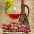 Ceramic bottle, grapes and red wine — Stock Photo #2262104